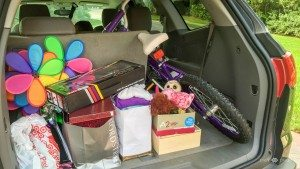 Loading up our car with gently used and some brand new Christmas gifts for donation.
