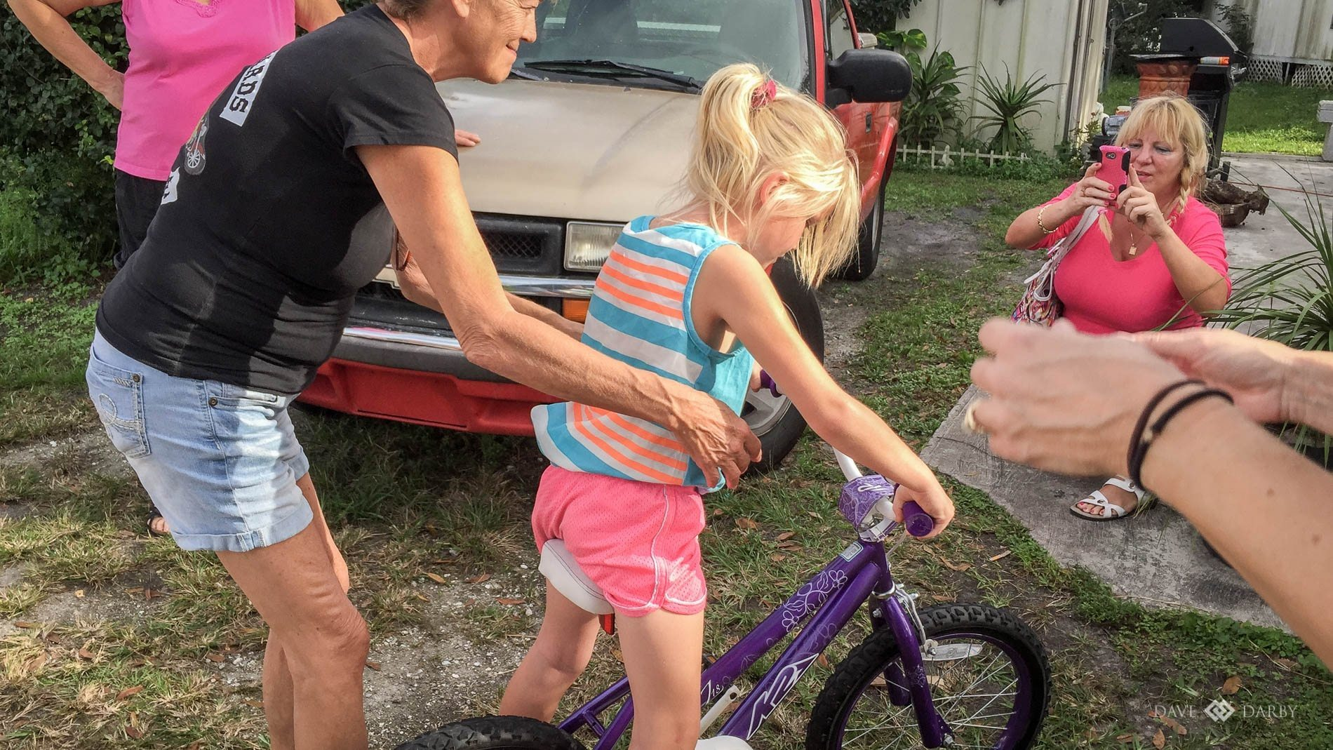 A happy little girl who had just told her Grandma that she wished for a bike for Christmas.